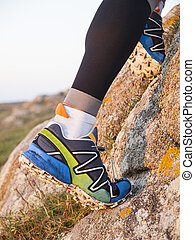 Extreme sports shoes for trail running practice in nature