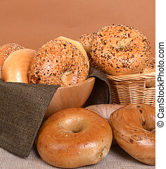 Variety of different types of bagels - A variety of freshly...