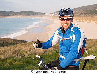 Cyclist expressing positivity with ok symbol outdoors