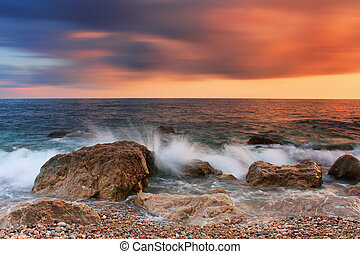 Stormy sea with a colorful sky