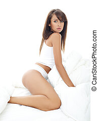 Beauty in Bed - Portrait of beautiful woman, she sitting on...