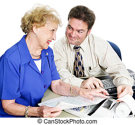 Accountant with Senior Lady - Handsome young accountant...