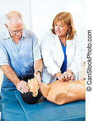 Teaching First Aid CPR - Doctor teaching first aid CPR to a...
