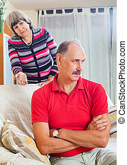 Tired mature man listening to angry wife - Family quarrel....