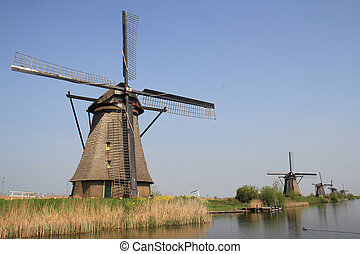 Windmills on the canal bank Typical Dutch rural landscape in...