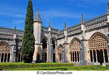 ornamental gothic medieval Batalha Monastery and garden,...