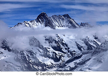 View of Jungfrau with clouds, Switzerland. The Jungfraujoch...