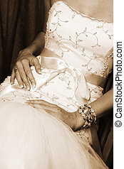 Wedding Gown - Bride sitting down, close up of detail on...