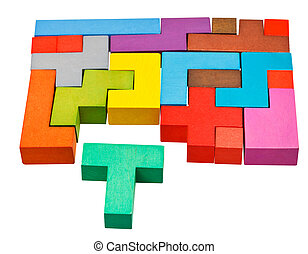 multicoloured puzzle blocks and T-shaped piece isolated on...