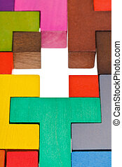 cross hole in wood multicoloured puzzle