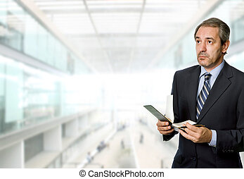 pensive mature business man at the office