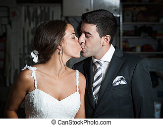 bridal couple kissing each other