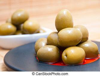 Olives in a black plate