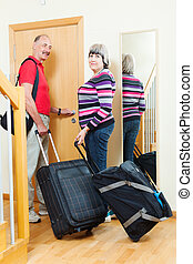 mature couple with luggage   going on holiday