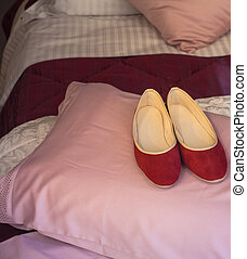 Red slippers - Red female slippers on the pink pillow