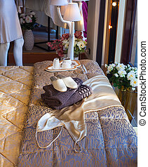 White slippers - White female slippers on the towels in the...