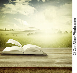Open book on table in front of spring background