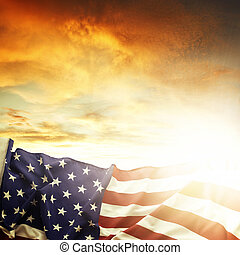 American flag in front of bright sky
