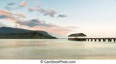 Sunrise over Hanalei Bay Kauai Hawaii - Rising sun...