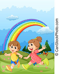 Kids playing at the hilltop with a rainbow in the sky -...