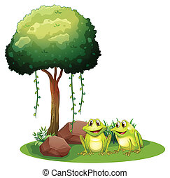 Two smiling frogs beside the tree