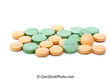 Orange and green tablets isolated on the white background