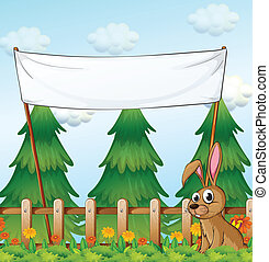 A rabbit near the wooden fence below the empty banner