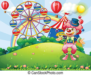 A clown juggling at the hilltop across the carnival -...
