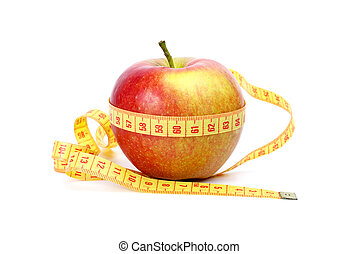 Yellow-red apple and measurement tape - Healthy eating and...