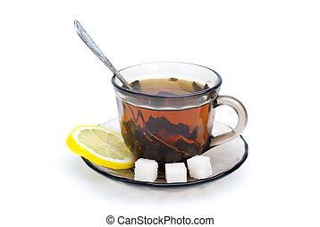 Teacup with black tea, teaspoon, dish, lemon slice and some...