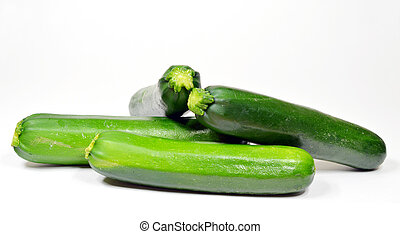 zuchini - Four whole organic zuchini on white background