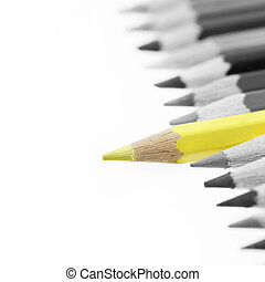 Pencils - One yellow pencil standing out from others