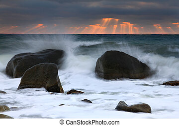 Stormy sea at sunset
