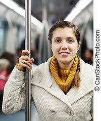 girl passanger standing in metro - girl passanger standing...