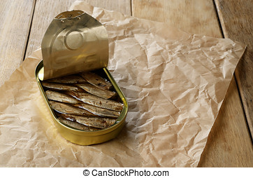 Opened Sprat tin can on the table