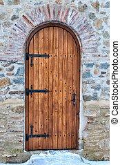 Wooden door with arch