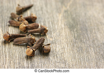 Cloves close-up - Close-up of cloves on wooden background.