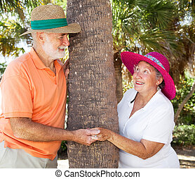 Seniors Playing Peekaboo - Senior couple in love, flirting...
