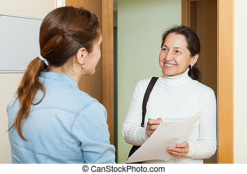 Mature woman polling among the population at home door