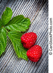 Closeup of raspberries and a leaf