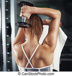 Triceps - Cute Sporty young woman doing exercise in a...