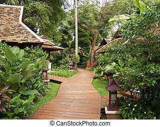 Wooden walkway and bungalows in Thailand