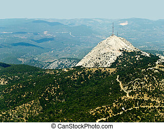 Telecommunications tower on mountaintop, aerial view