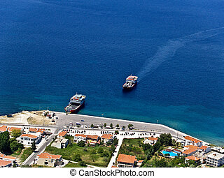 Ferryboats in Greek island\'s port, aerial view