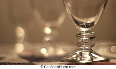 Glasses - Hd clip; focus shift on some wine glasses on a...