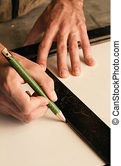 measure and mark - close-up of hands of a joinery while...