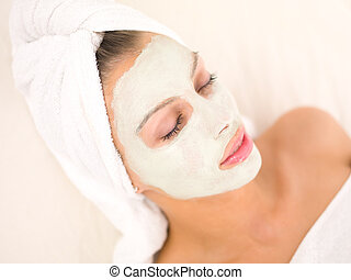 Daily Spa - Portrait of beautiful woman during spa treatment