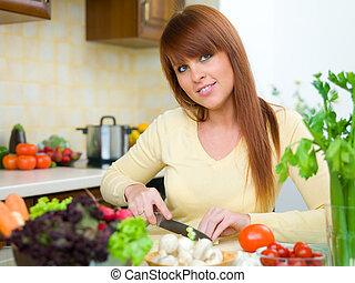 Woman in Kitchen - Beautiful woman in kitchen cooking meal