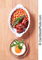 English breakfast of baked beans, sausages and fried egg