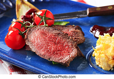Roast beef with scrambled eggs - Slices of roast beef with...